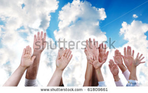 Many hands rising the sky together, children and adults - stock photo
